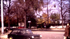 Old film Vienna Austria people crossing the street sunny day vintage historic Stock Footage