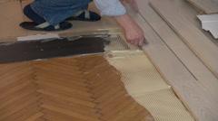 Worker installing wood floor parquet board Stock Footage