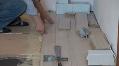 Worker fixing floor, parquetry, home improvement, home decorating Stock Footage
