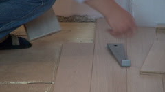 Worker fixing floor, parquetry, home improvement, home decorate Stock Footage