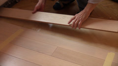 Worker fixing floor, parquetry, home improvement, home decorate - stock footage