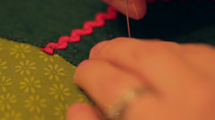 Sewing on a button Stock Footage