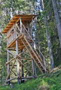 Wooden huts for bird-watching and hunting of birds in the mountains Stock Photos