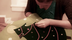 lady sewing christmas advent calendar - stock footage