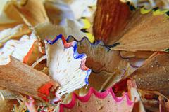 Colored pencils of wood chips after the sharpener Stock Photos