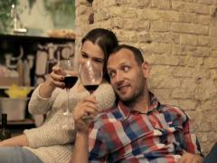 Attractive couple raising toast with glass of the red wine NTSC - stock footage