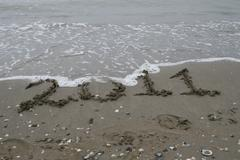 farewell to 2011 written in the sand on the seashore - stock photo