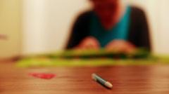 mother working on a christmas advent calendar rack focus - stock footage