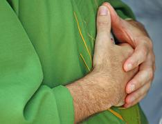 Hands clasped in prayer the priest with  dress Stock Photos