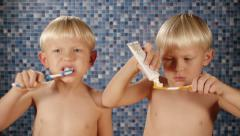 children brushing teeth - stock footage