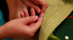 a mother sewing a christmas advent calendar - stock footage