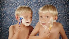 Children shaving with razors Stock Footage