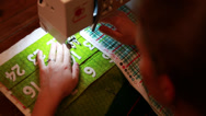 Stock Video Footage of using a sewing machine to make advent calendar