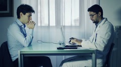 Doctor and patient discussing scan results in diagnostic center - stock footage
