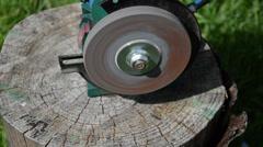 Sharpening blade on black electric sharpener Stock Footage