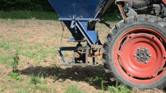 Machine tractor wheel and seeder equipment sow buckwheat seeds Stock Footage