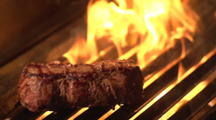 Steak On Grill Fire 01 - Slow Motion Stock Footage