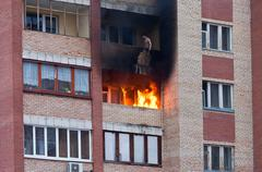 Fire in one of the apartments of a large tenement-house Stock Photos