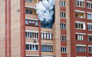 Stock Photo of fire in one of the apartments of a large tenement-house