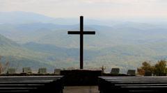 Cross hazy autumn mountain silhouette Stock Footage