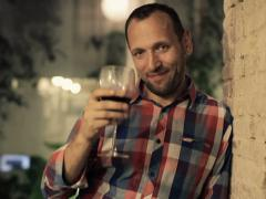 Happy man raising toast to camera with glass of wine NTSC - stock footage