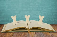 paper cut of xxx adult  on old book - stock photo