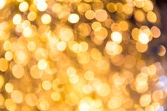 Bokeh defocused gold abstract christmas background Stock Photos