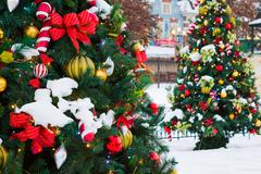 christmas tree with decoration and snow - stock photo