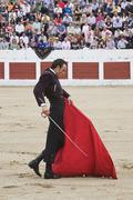 the spanish bullfighter finito de cordoba bullfighting with the crutch  - stock photo