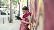 Stock Video Footage of Young trendy woman with tablet computer stand by graffiti wall HD