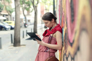 Stock Video Footage of Young trendy woman with tablet computer stand by graffiti wall NTSC