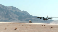 C-130 Hercules taking off from an operational airstrip Stock Footage