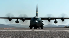Head on view of a C-130 Hercules transport aircraft Stock Footage