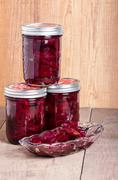 Pickled beets in jars and bowl Stock Photos