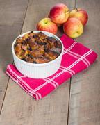 apple bread pudding with raisins - stock photo