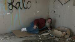 Abandoned building bedroom homeless man in corner HD 1548 Stock Footage