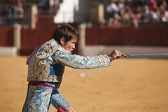 young bullfighter stabbing a bull, baeza, jaen province, spain, 27 june 2007 - stock photo