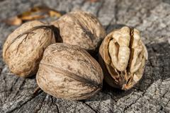 Whole and broken fresh walnuts - stock photo