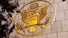 United States Emblem Logo Seal Insignia In Gold On Building- Full Sun Stock Footage