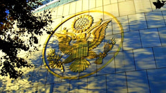 United States Emblem Logo Seal Insignia In Gold On Building- Shaded Stock Footage