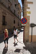 tourists walk along the monumental area of ubeda, patrimony of the humanity,  - stock photo