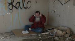 Abandoned building discouraged homeless man in corner HD 1548 Stock Footage