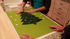 women make christmas advent calendar for craft time - stock footage