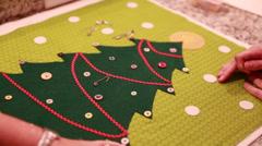 women pinning a christmas advent calendar - stock footage
