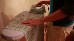 Woman ironing fabric Stock Footage
