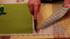a woman cuts fabric for christmas advent calendar - stock footage