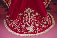 Embroidering with gold thread work on red velvet, spain Stock Photos