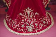 Stock Photo of embroidering with gold thread work on red velvet, spain