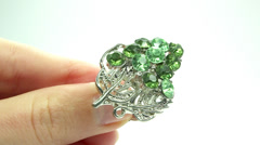 Jewelery ring with green emerald crystals purring on the finger Stock Footage