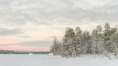 Delicate sunset during a snowstorm Stock Footage